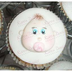 View the Baby Face silicone cupcake top icing mould online at Cake Stuff