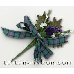 View the Flower of Scotland tartan ribbon buttonhole / cake spray online at Cake Stuff