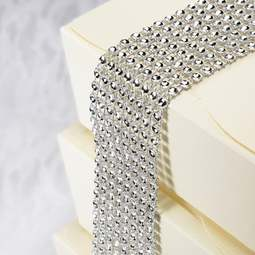 View the SILVER plastic diamante cake band - 8 rows / 40mm wide x 1.5m online at Cake Stuff