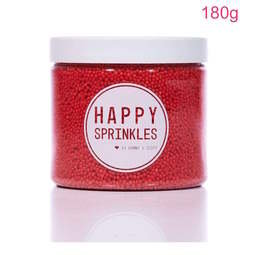 View the 180g RED 100s & 1000s / Non Pareils mini sugar pearl sprinkles online at Cake Stuff