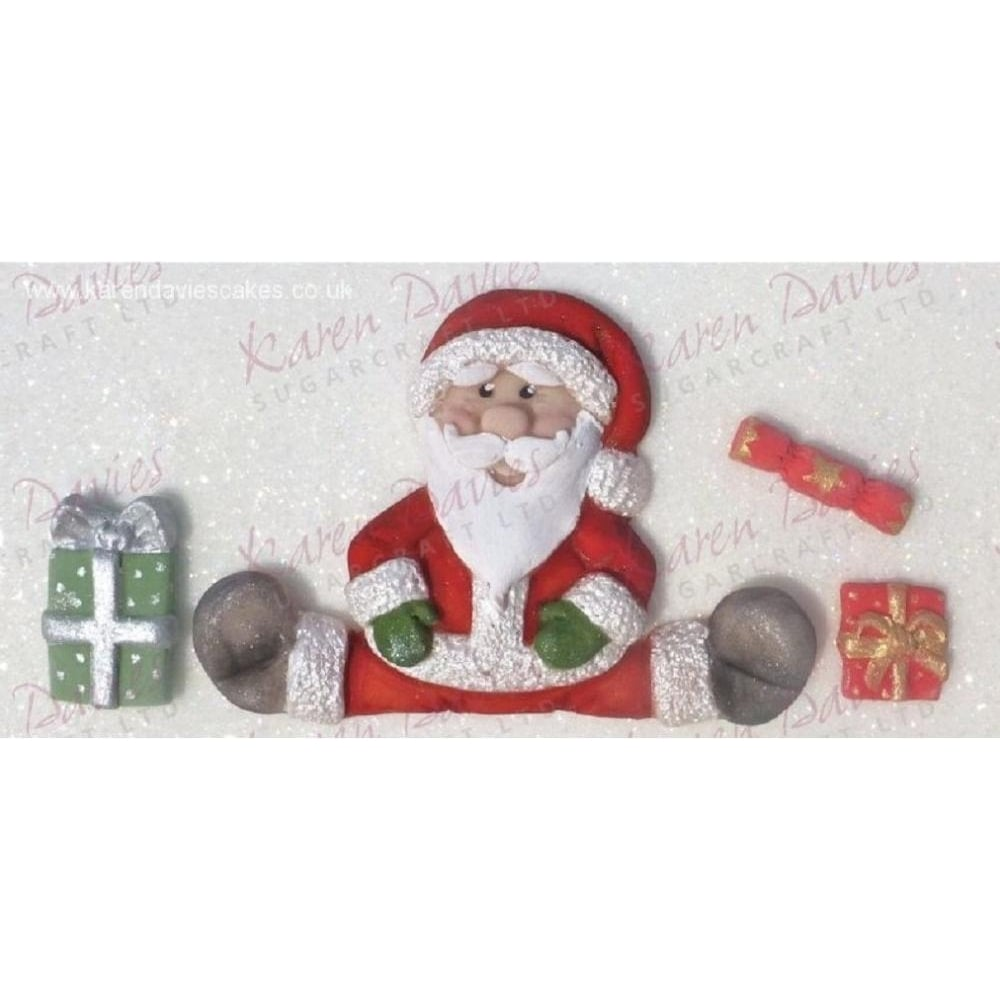 View the SITTING SANTA silicone icing mould online at Cake Stuff